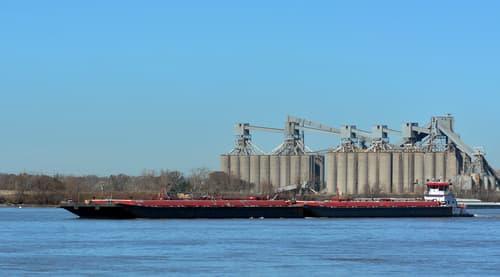 Tug Pushing Barge On Mississippi River