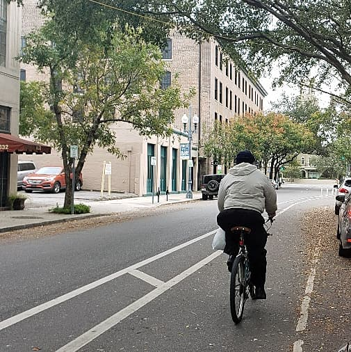 New Orleans Bike Lane - Man Riding Bike In Bicycle Lane New Orleans