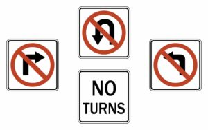"""The city traffic engineer may determine those locations at which drivers of vehicles shall not make a right, left or """"U"""" turn and shall place proper signs at such locations. The making of turns may be prohibited between certain hours of any day and permitted at other hours, in which event, such hours shall be plainly indicated on the signs or they may be removed when such turns are permitted."""