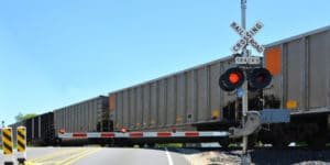 Whenever any person driving a vehicle approaches a railroad grade crossing under any of the circumstances stated in this section, the driver of such vehicle shall stop not less than 15 feet from the nearest rail of such railroad and shall not proceed until he can do so safely.